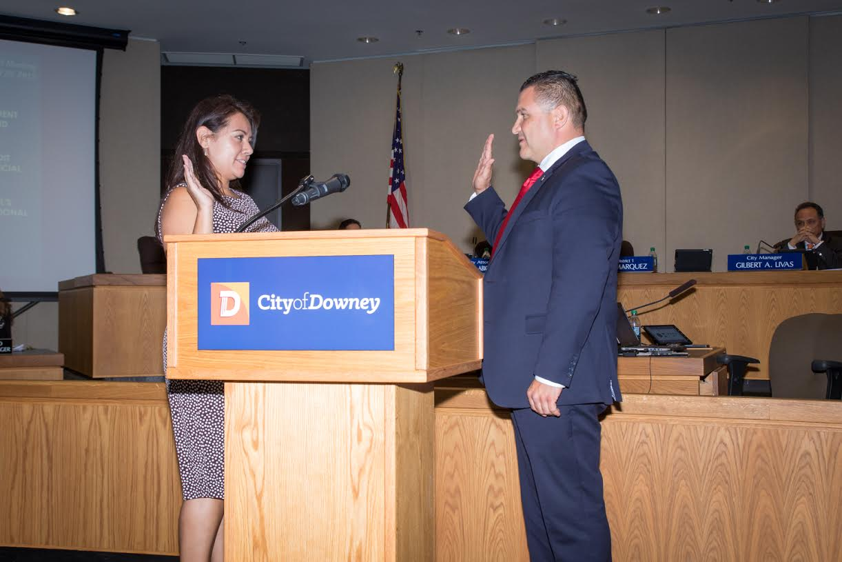 Mayor Luis Marquez is sworn-in to the San Gabriel and Lower Los Angeles Rivers and Mountains Conservancy by city clerk Adria Jimenez.