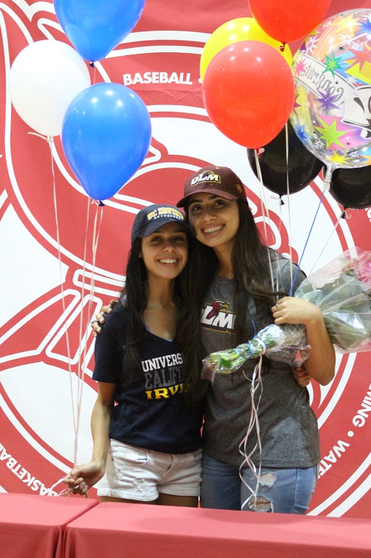 Brittney Martinez, left, and Idalis Gonzalez celebrate after the signing day ceremony.