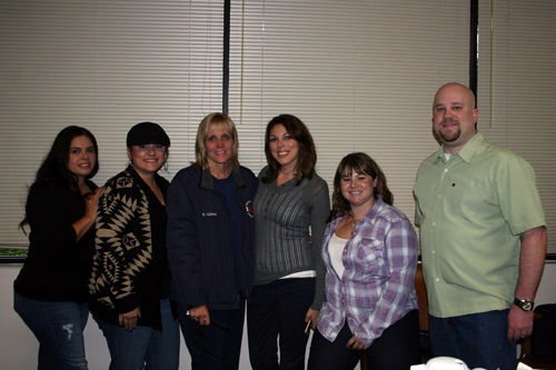 Photo courtesy Downey Police Department  Communications supervisor Heidi Calhoun, third from left, and other police dispatchers. Calhoun retired recently after 31 years with the department.