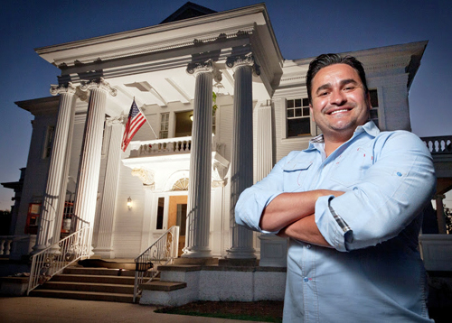 Ralph Verdugo stands in front of the Rives Mansion. Photo by Martin Trejo
