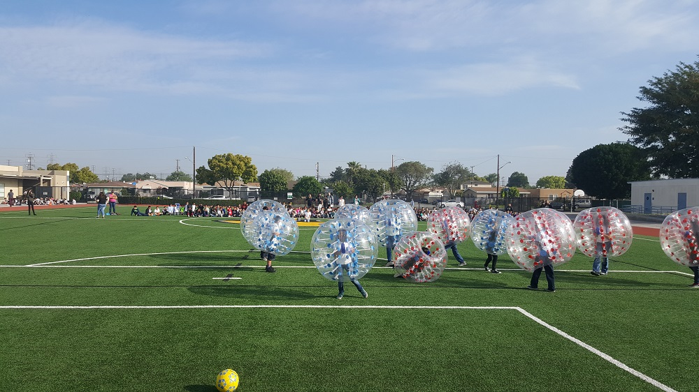 Jackson Middle School students compete in a game of Bubble Soccer, one of the fundraising incentives for students during Paramount Unified School District's inaugural March Madness fundraiser