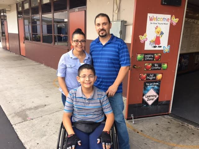 Los Nietos eighth-grader Jared Avalos with his mother, Nora, and his father, Sergio. Jared has excelled in the MESA program and beyond despite a neurological condition that makes walking difficult.