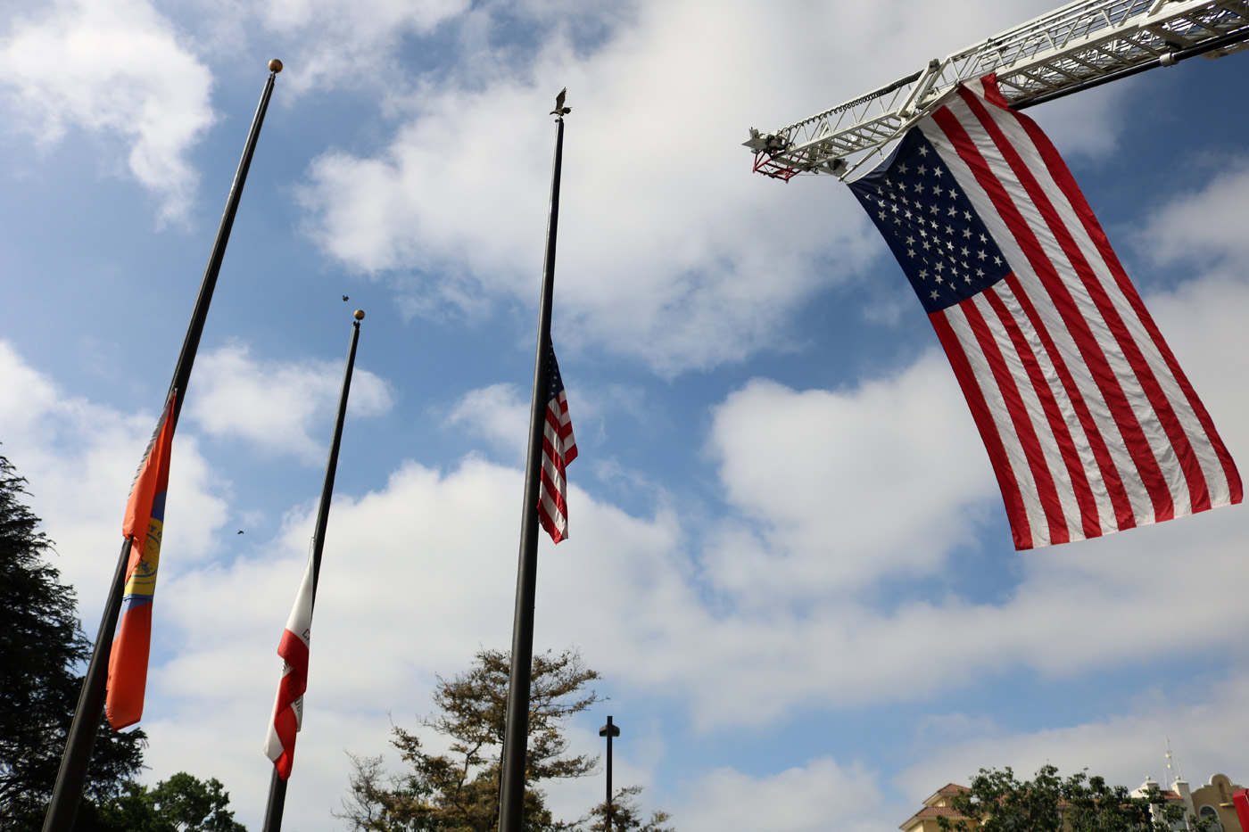 The American flag flies at a 9/11 ceremony in Downey. Photo by Alex Dominguez