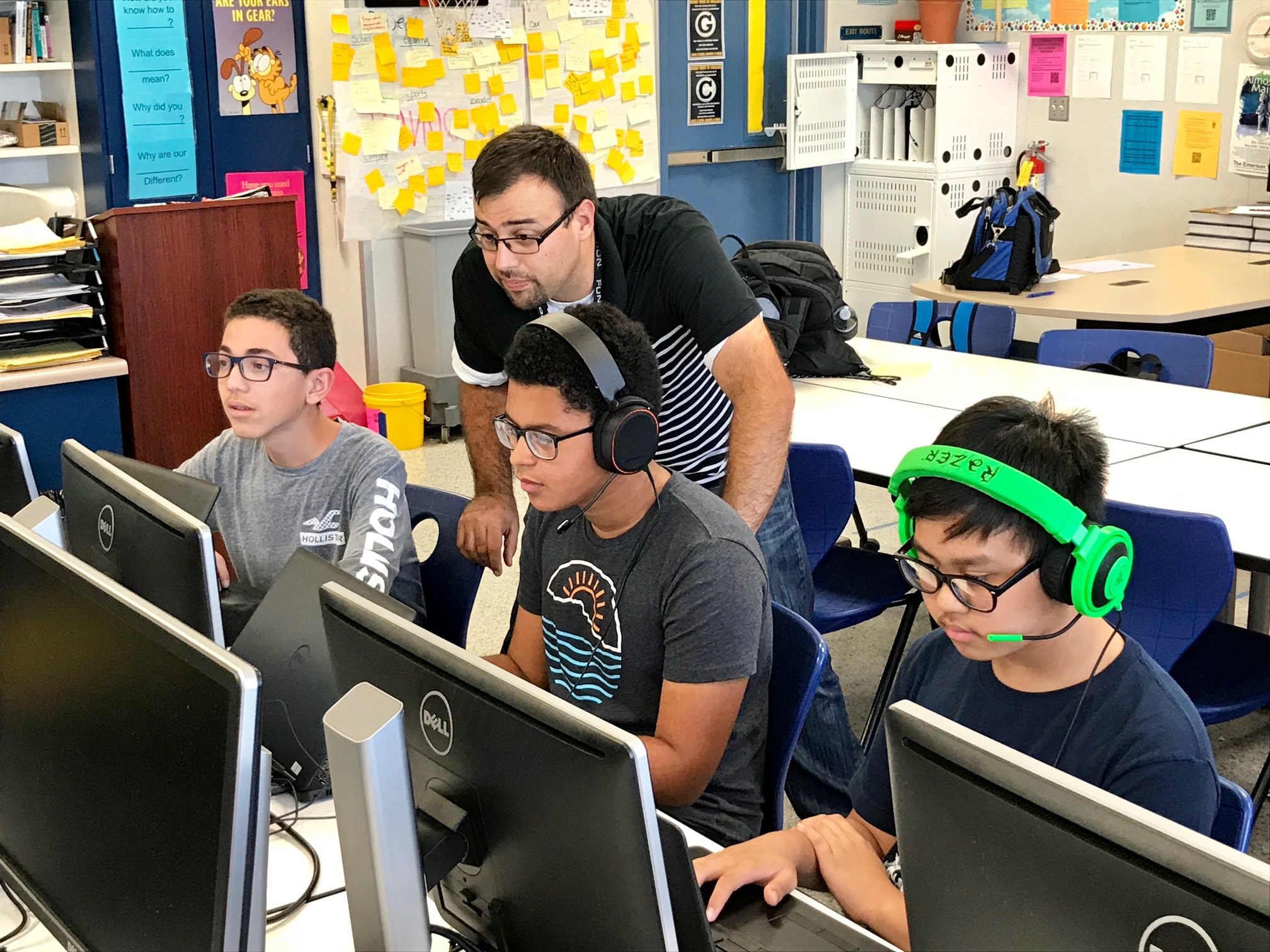 David Quintero, a math, computer science, and engineering teacher at Warren High School, oversees a participating eSports team practicing before the program officially kicks off on Wednesday, Oct. 10.