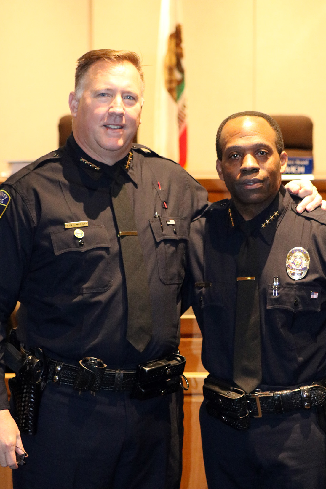 Police Chief Dean Milligan and former Police Chief Carl Charles. Photo by Alex Dominguez
