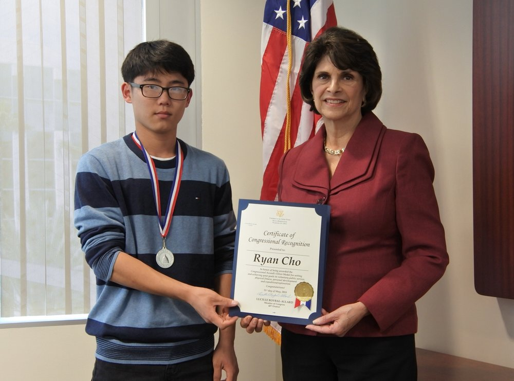 Ryan Cho, left, receives a certificate of congressional recognition from Rep. Lucille Roybal-Allard.