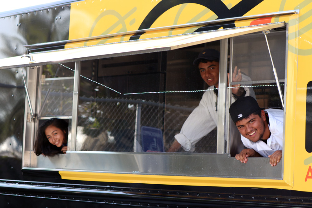 Warren High School students inside a Downey Unified food truck. Photo by Alex Dominguez