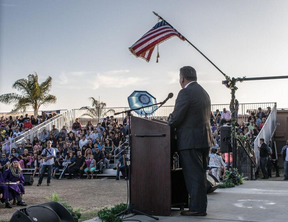 Rick Rodriguez speaks at Columbus High School graduation ceremonies. Photo courtesy City of Downey