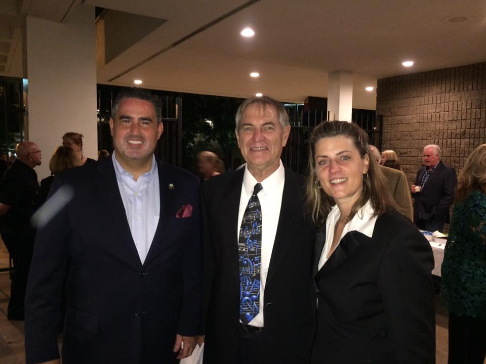 Lars Clutterham, center, flanked by Councilmember Alex Saab and Downey Symphony music director Sharon Lavery.