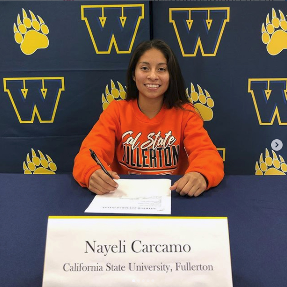 Warren High senior Nayeli Carcamo will play soccer for Cal State Fullerton after signing a letter of intent last week.  The signing ceremony was attended by Nayeli's coaches and teammates. Photo courtesy Warren High soccer.