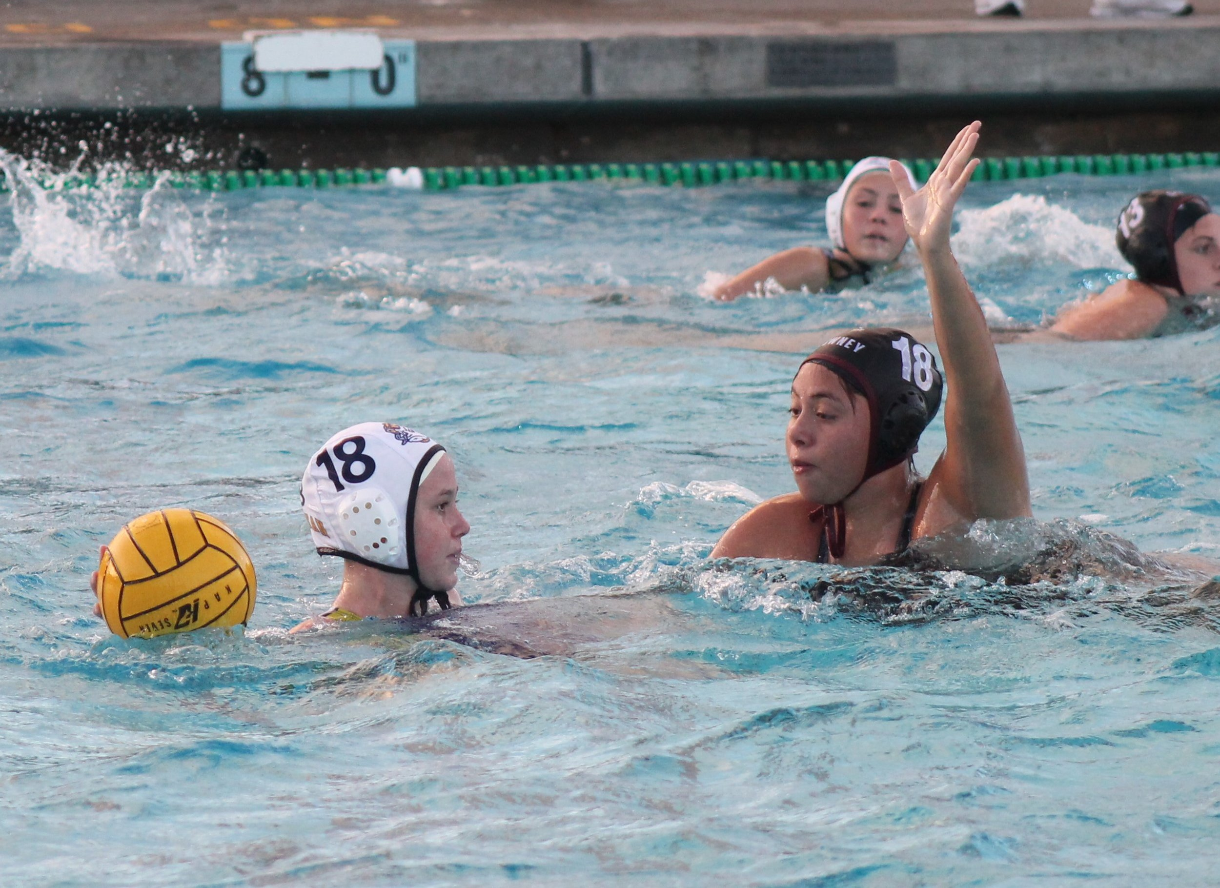 PHOTO BY DAVID CASILLAS   Downey's Alondra Villa defends against a Millikan attacker. Downey girls water polo beat Millikan, 8-6, on Tuesday in the first round of CIF playoffs.
