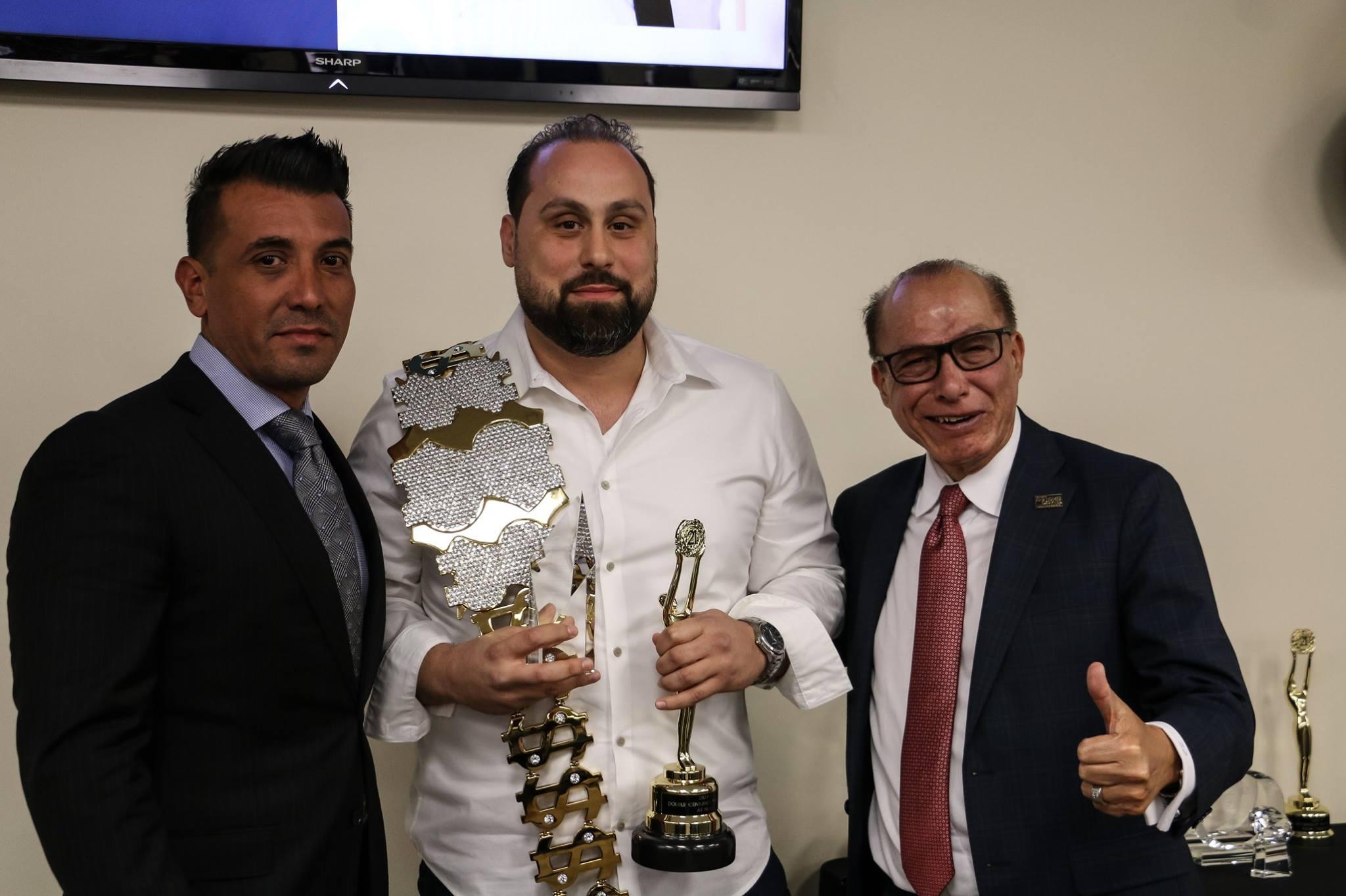 Ali Hijazi, center, earned Century 21's Grand Centurion Producer Award. Photo courtesy Century 21 A Better Service Realty.