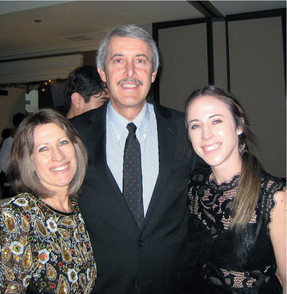 Downey Family YMCA honoree Charles Gregorio, wife Melody, and daughter Emily. Photo by Lorine Parks