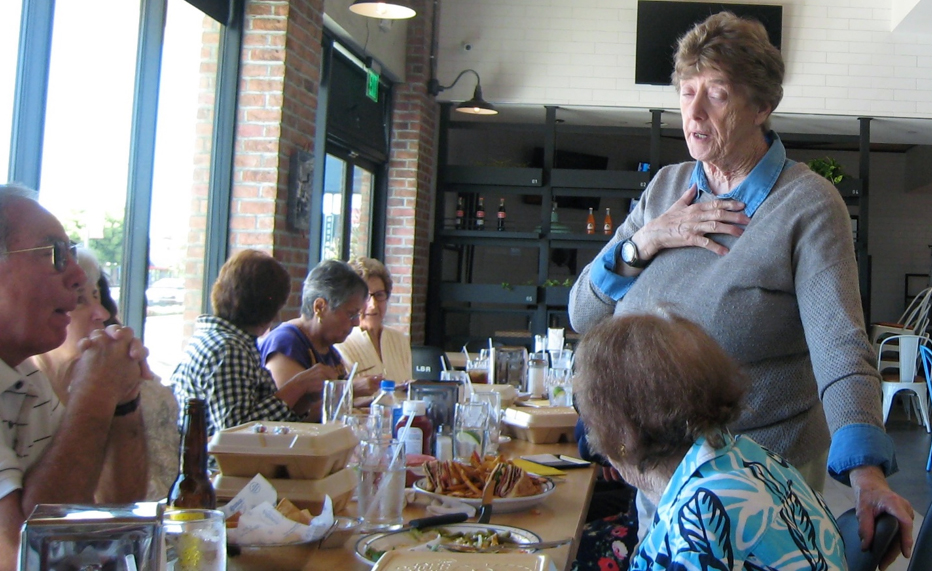Shirley Johnson speaks to her lunch group. Photo by Lorine Parks