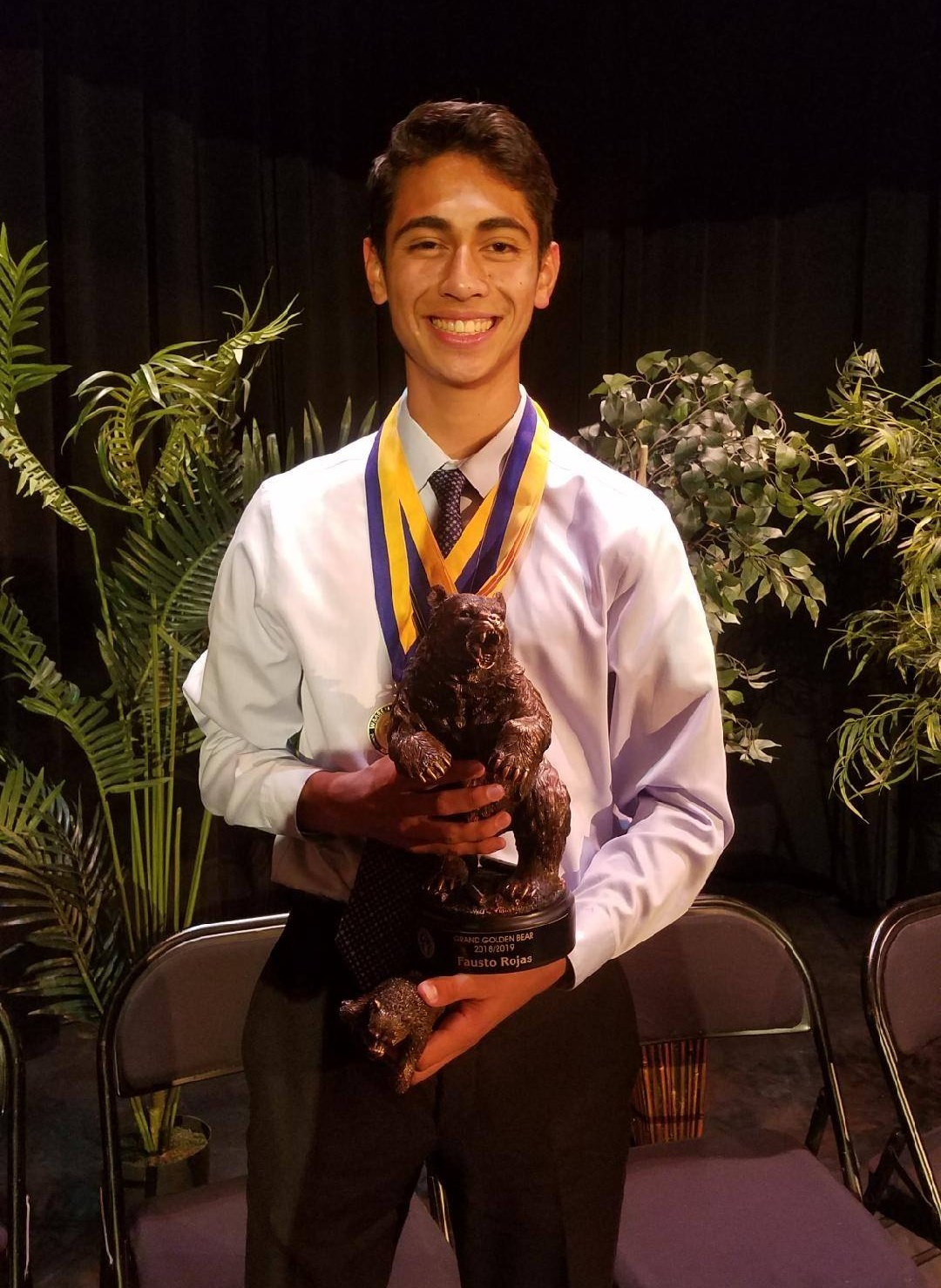 Warren High School senior Fausto Miguel Rojas receiving the Grand Gold Bear Award at Warren's Golden Bear Awards Ceremony.