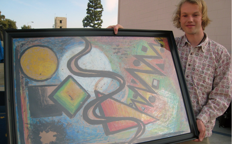 Scott Salmon with his original artwork. Photo by Lorine Parks