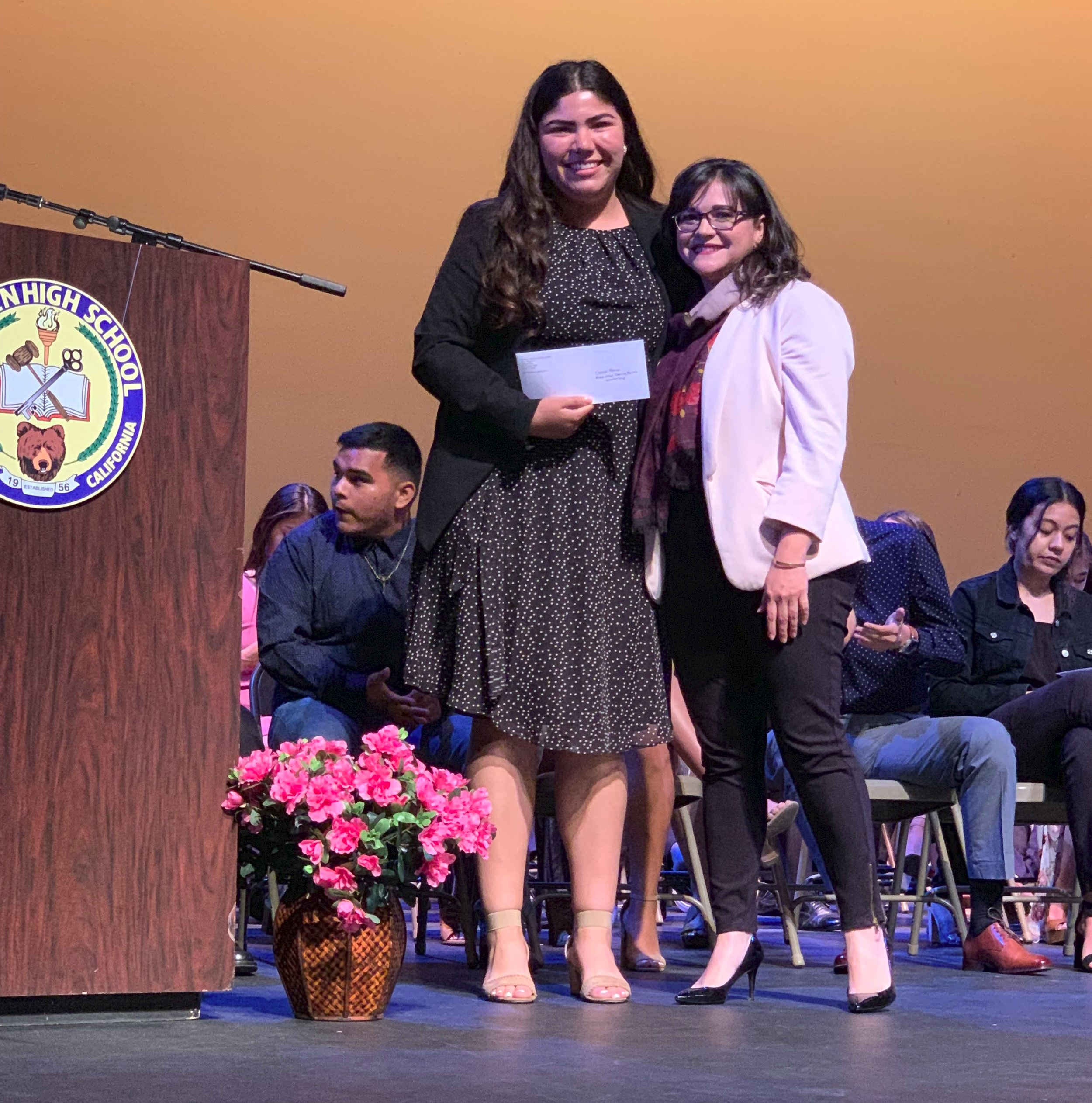 Warren High School graduating senior Cheyla Farias received the scholarship from Rockview Family Farms' Tatiana Rodriguez at an assembly on May 23.