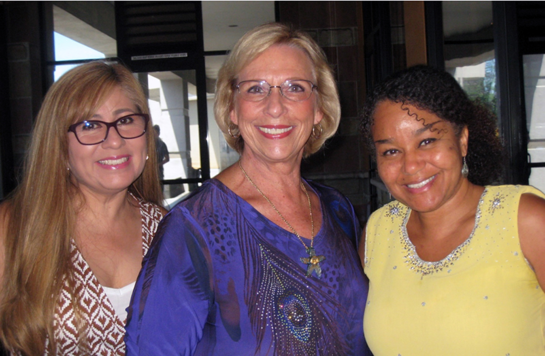The installation committee of (from left) Rebecca Reyes, Linda Haines and Dr. Nina Smart. Photo by Lorine Parks