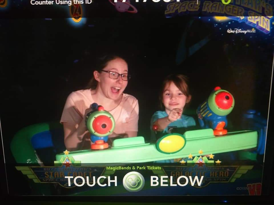 My daughter and I blasting targets on Buzz Lightyear Space Ranger Spin