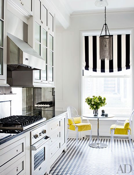 yellow chairs in black and white kitchen