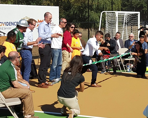 Ricki Ruiz of the Rockwood Initiative cuts the ribbon to open SNAKE Court.