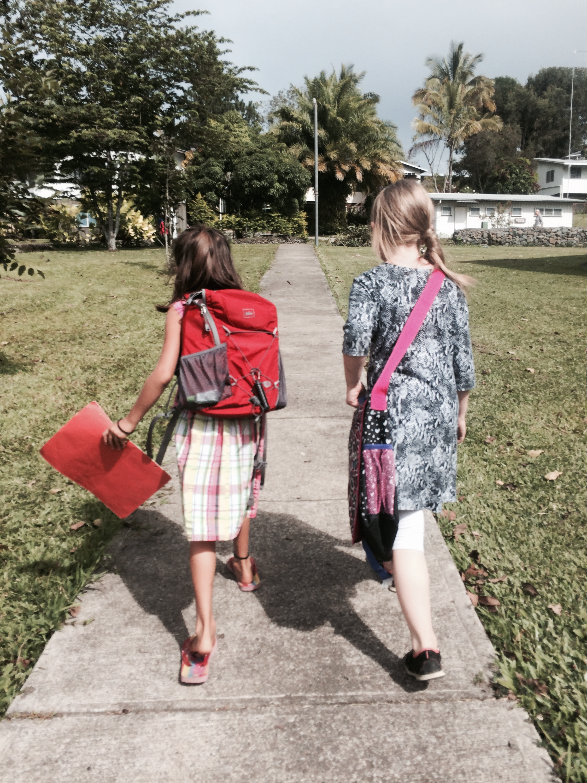 Walking home from school with one of her new friends/classmates (Small world - we know this little girl's grandparents in the midwest!)