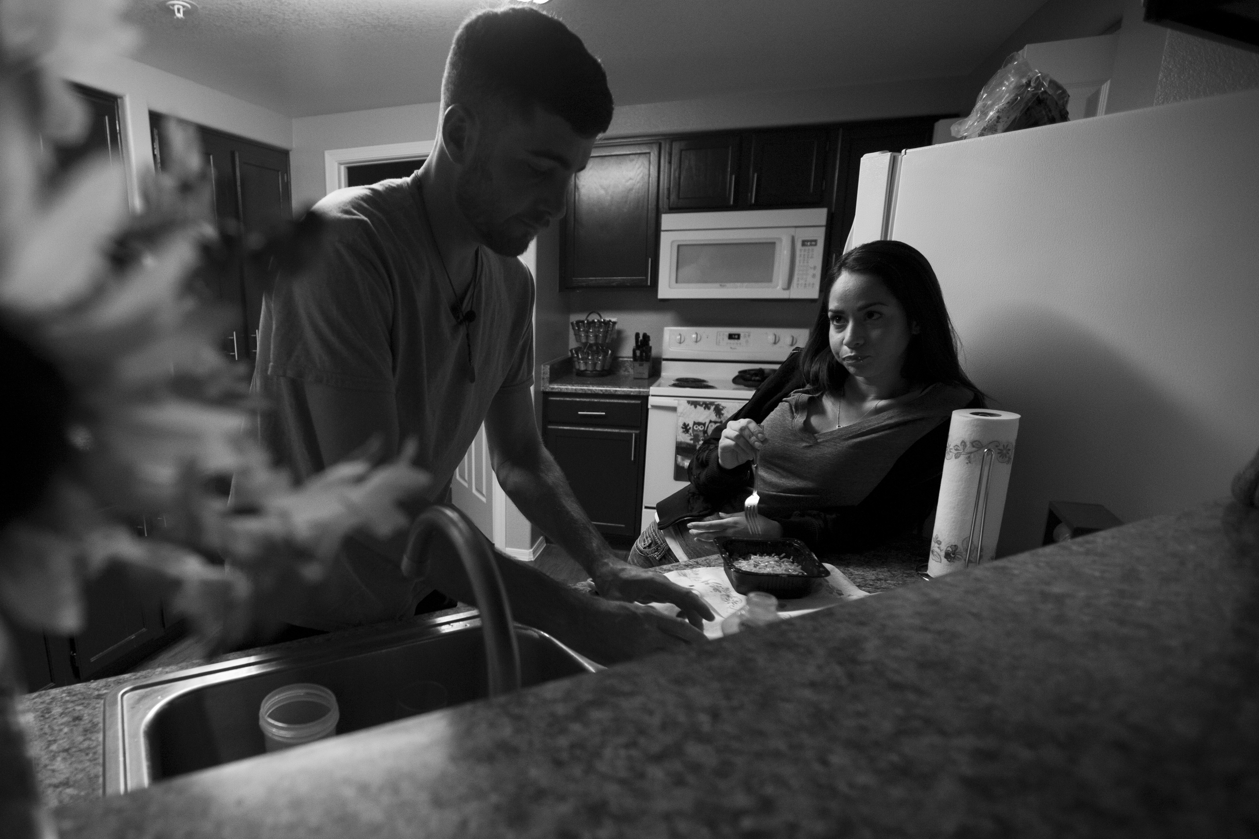 """Dezarae and Paul eat dinner at her apartment in Chandler. They have experienced periods of sobriety and relapse. """"If one's in, the other's not,"""" she said."""
