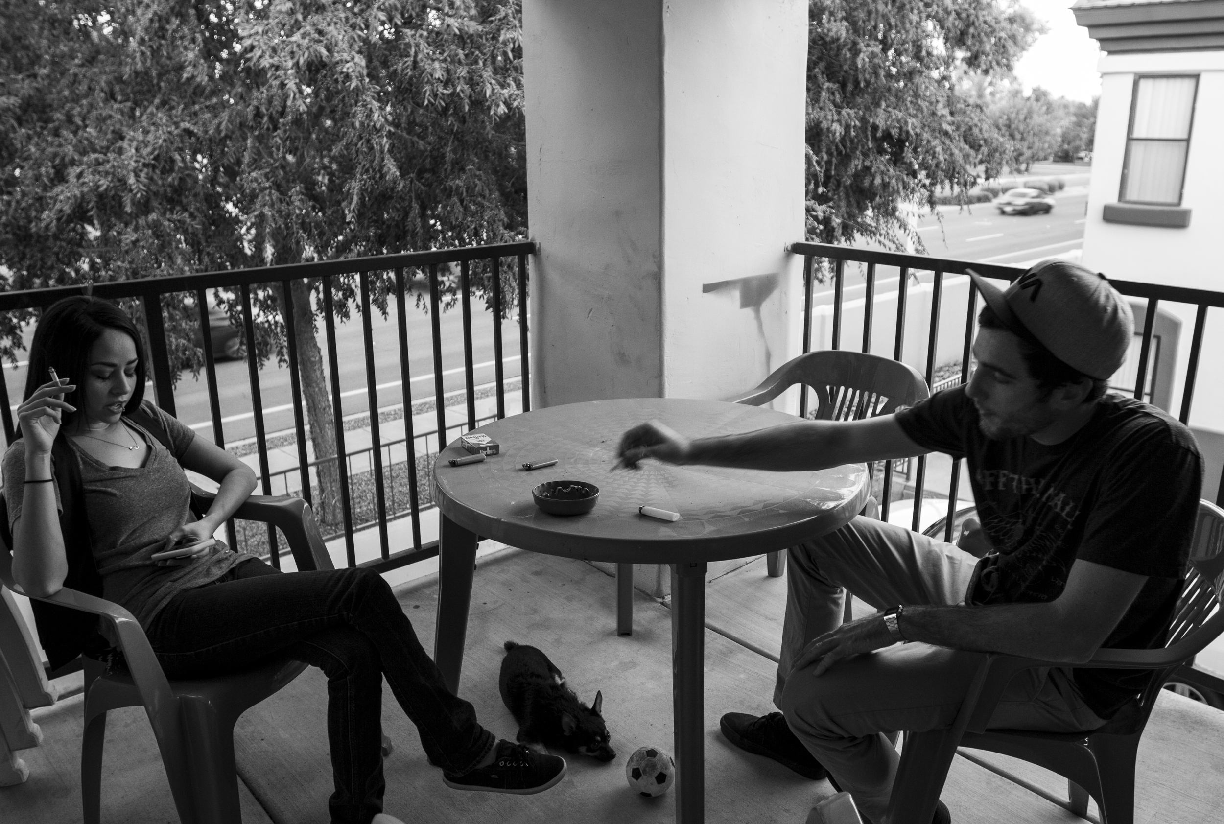 Dezarae and Paul smoke together on her patio. The two argued about whether addiction is a hereditary disease or if it is something that happens after incessant use.