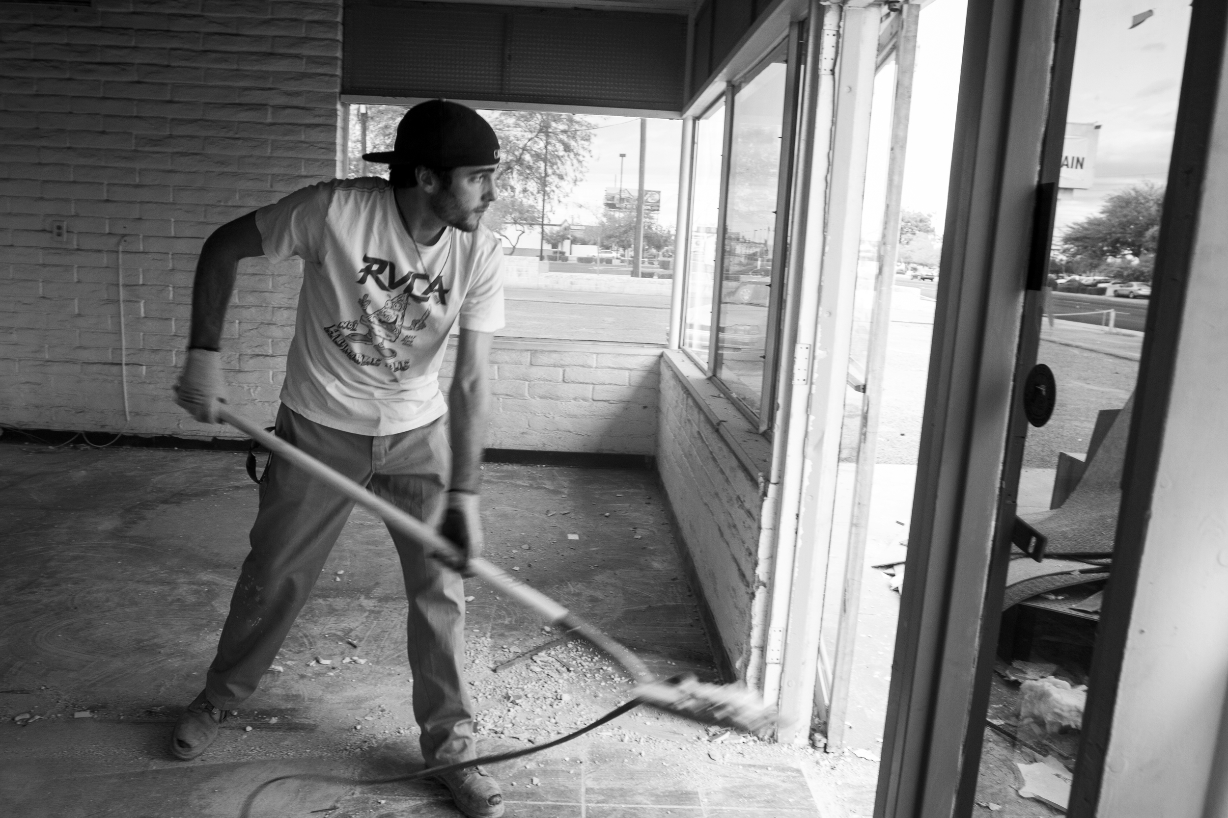 Paul shovels debris while helping his sponsor with construction work in Mesa. One of the requirements for being in his sober living house was obtaining a job within two weeks of admission into the program.