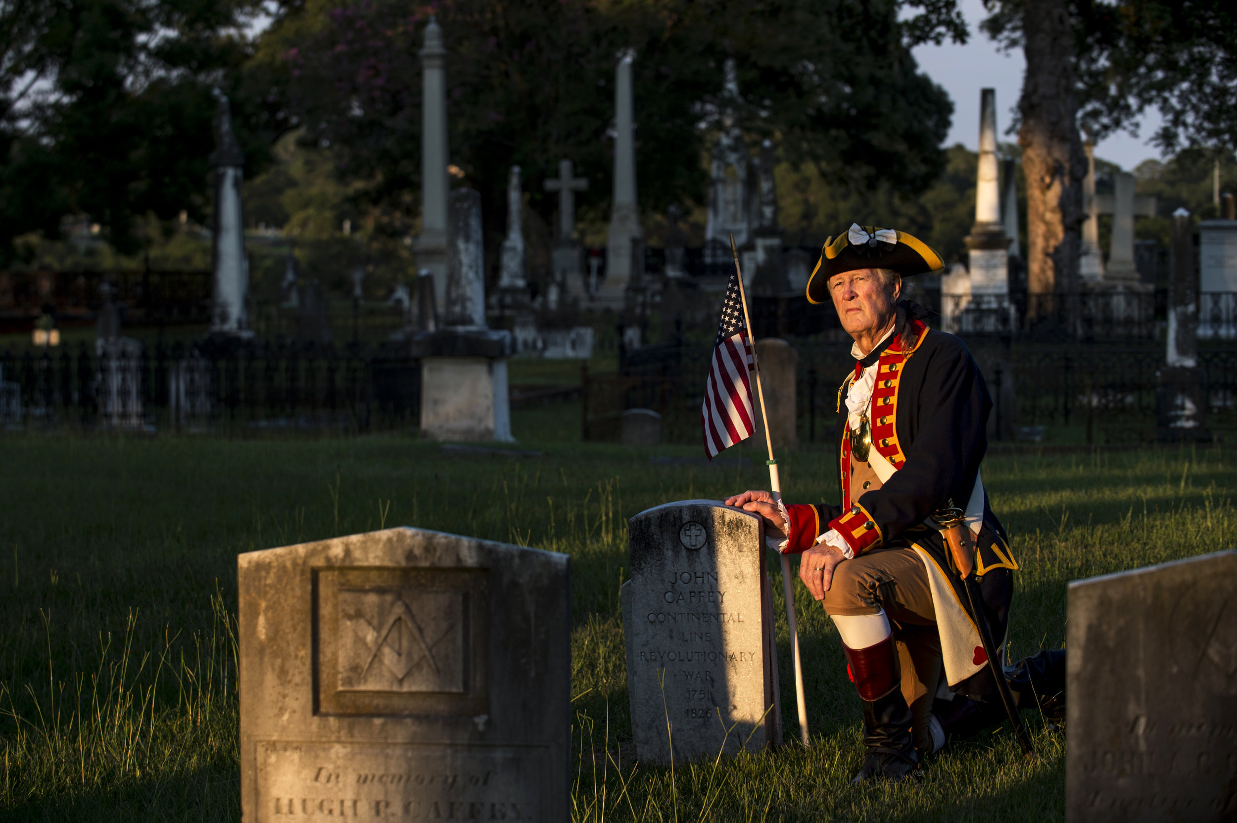 Larry Cornwell poses for a portrait next to the grave of John Caffey, who fought in the Revolutionary War, at Oakwood Cemetery in Montgomery, Ala. Cornwell is the Genealogist General for the Sons of the American Revolution, and has located six graves of Revolutionary War patriots buried in Montgomery.
