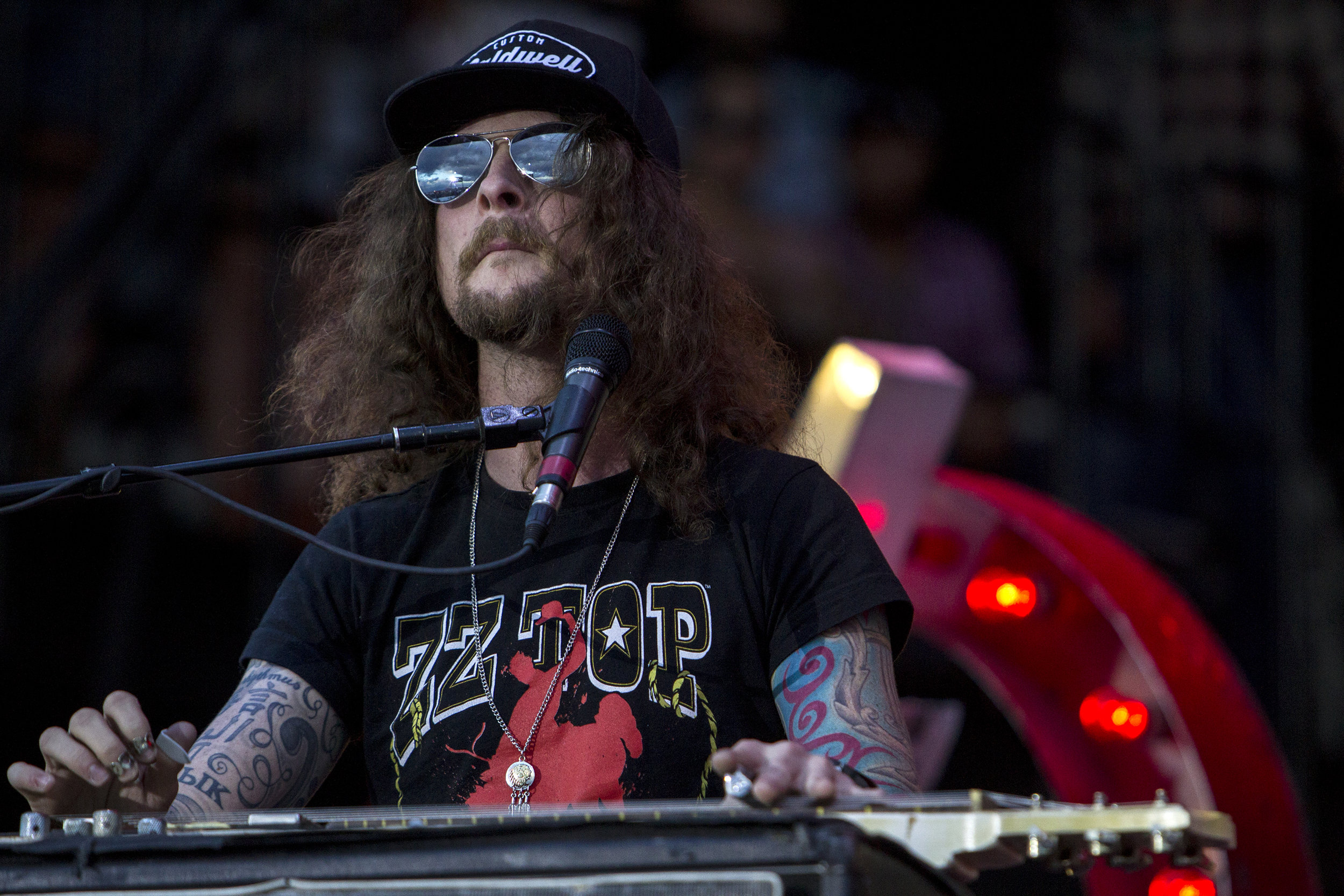 Kelby Ray of The Cadillac Three performs during Country Thunder in Florence, Ariz.