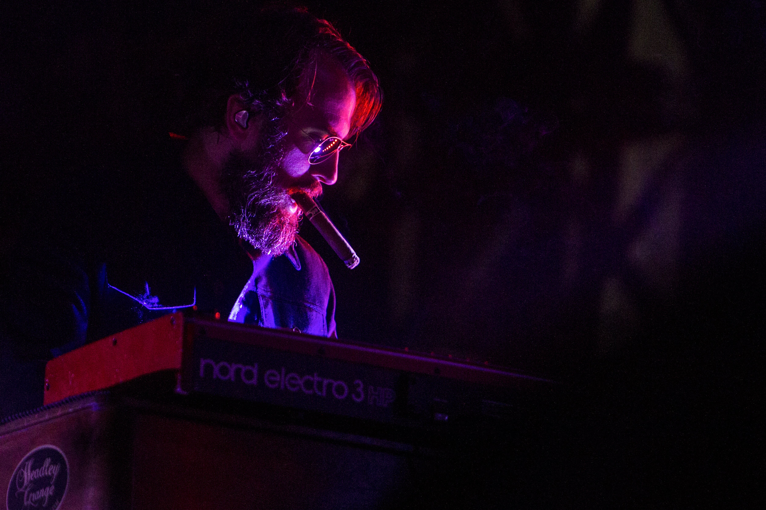 A keyboardist for Randy Houser performs during Country Thunder in Florence, Ariz.