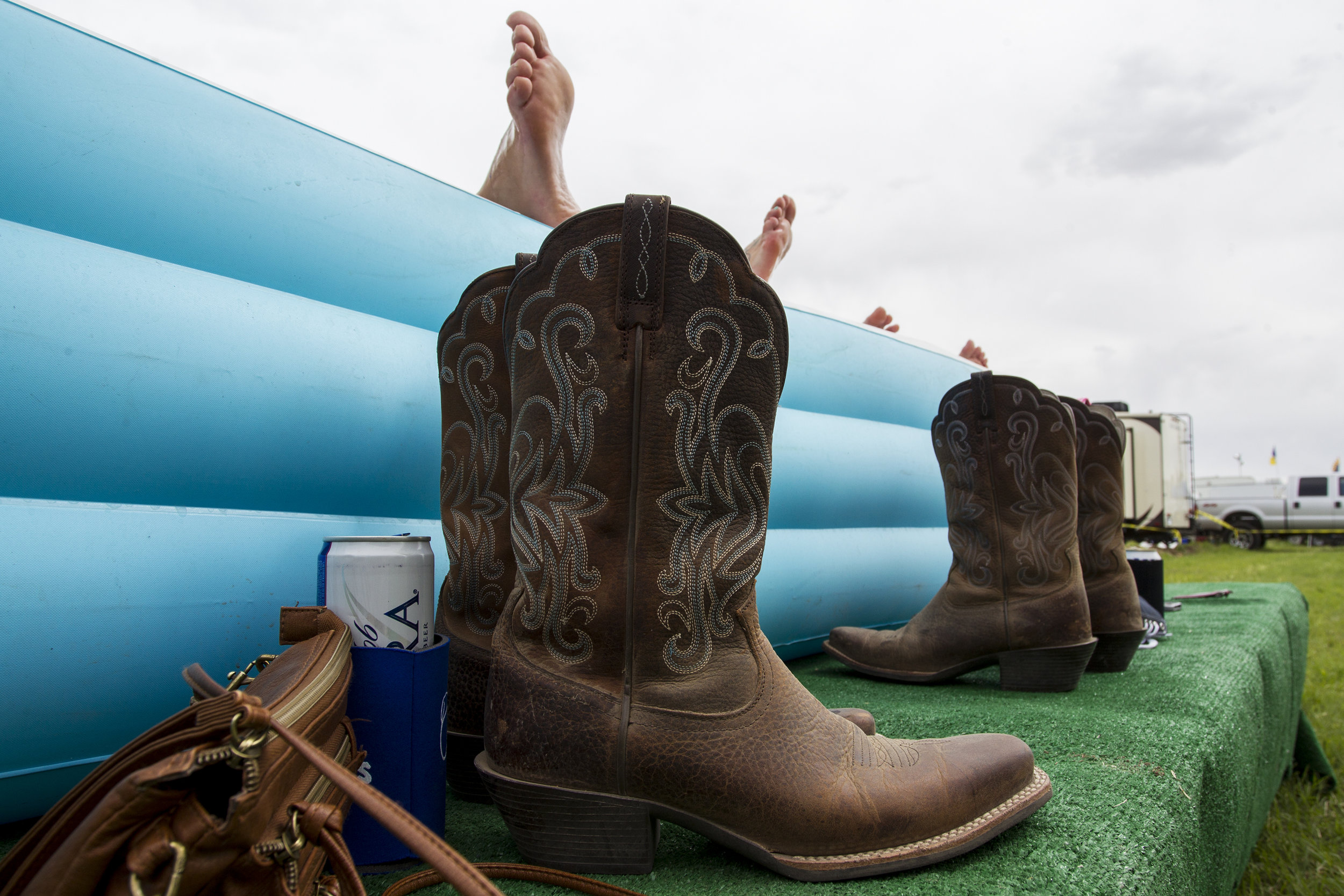 Festival-goers relax in a pool at a campsite during Country Thunder in Florence, Ariz.