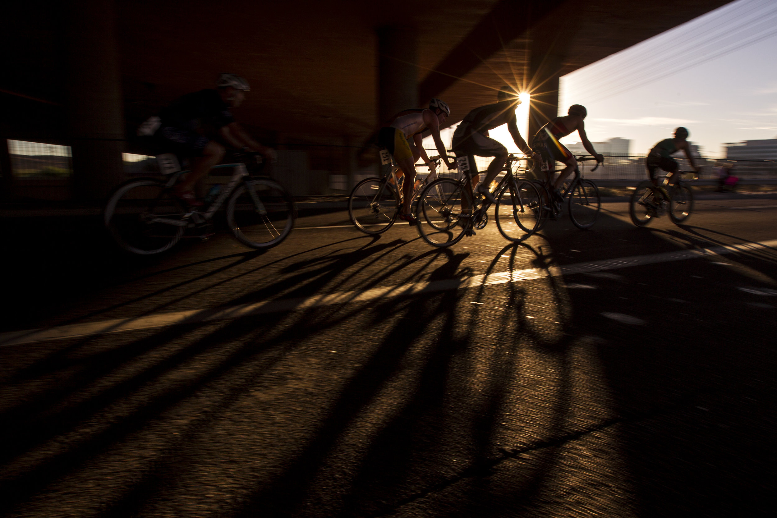 Cyclists ride on the Mill Avenue Bridge during the Ignite the Fork Triathlon on Sunday, Nov. 5, 2017 at Tempe Town Lake in Tempe, Ariz.