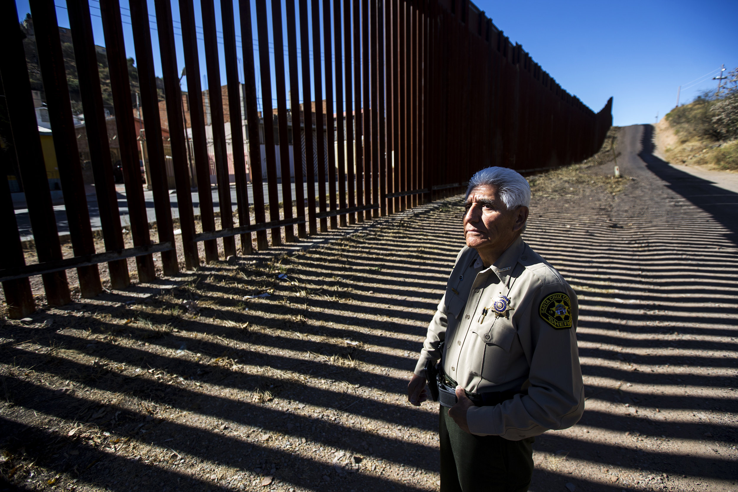 Santa Cruz County Sheriff Tony Estrada poses for a portrait at the United States border with Mexico in Nogales, Ariz.