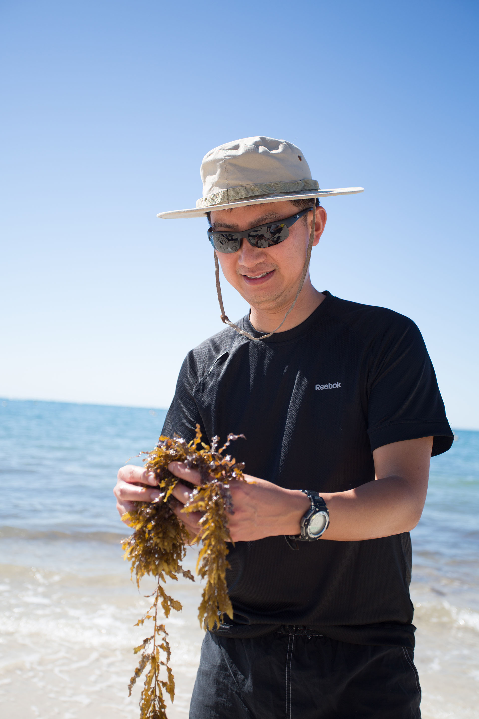 John holding a bunch of seagrasses