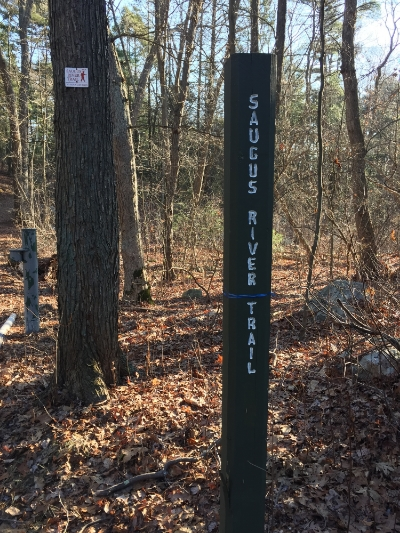 Sign for the Saugus River Trail right by the Visitor's Center.