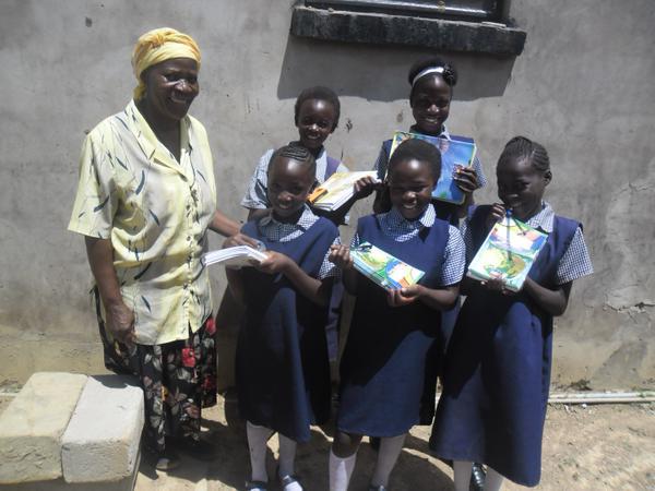 young girls w school supplies.jpg