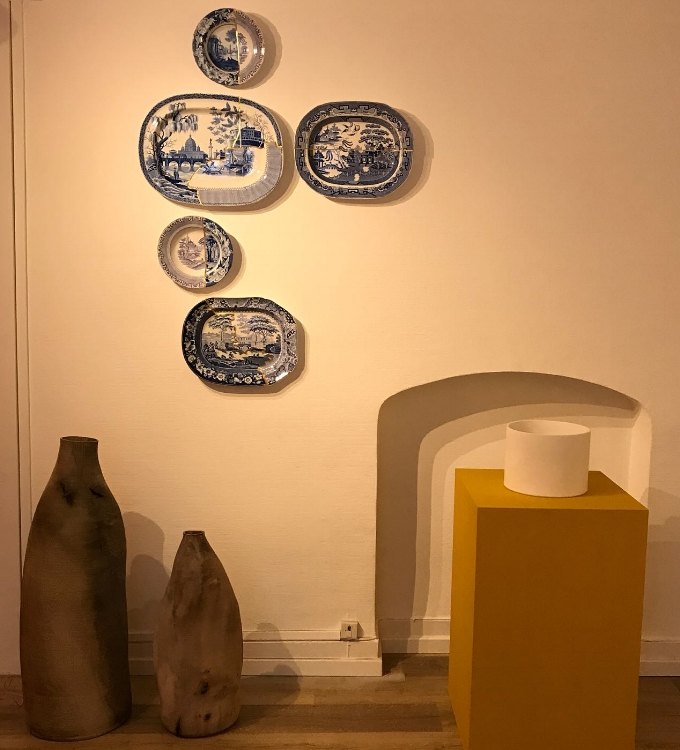 Wall installation by Paul Scott with [left] work by Ernst Gamperl and [right] Su Xianzhong