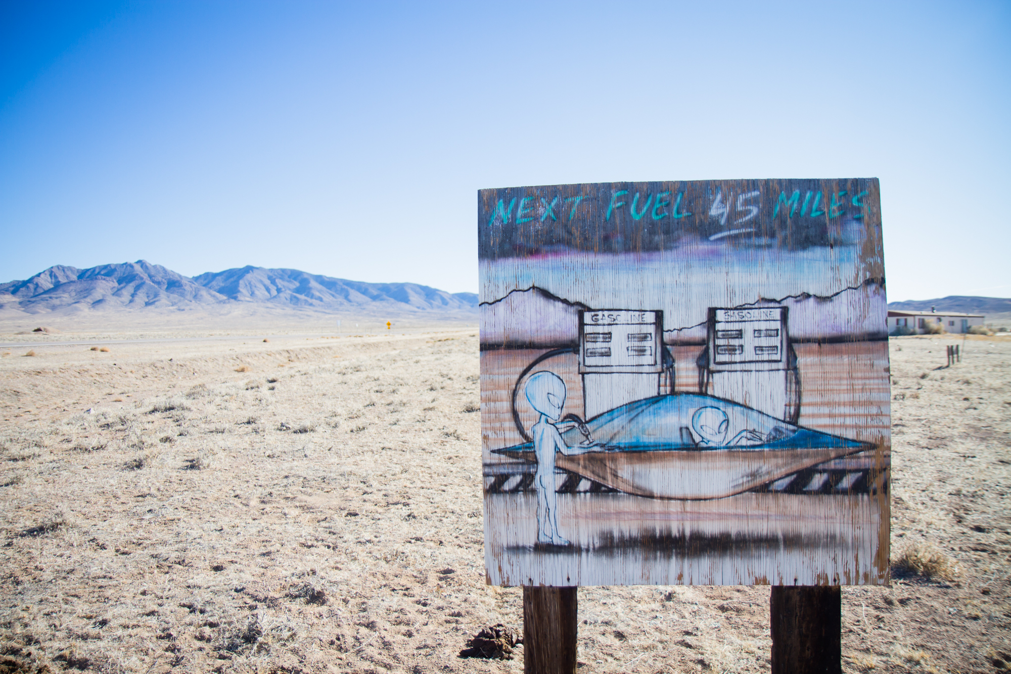 """Hand painted Alien Gasoline Sign - Flying Saucer """"Next Fuel 45 Miles"""" (Nevada) - Photo by Peter Kleeman 2012"""