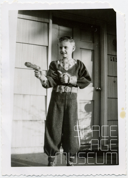 Boy in Tom Corbett, Space Cadet Uniform with Buck Rogers Pistol (circa 1955)
