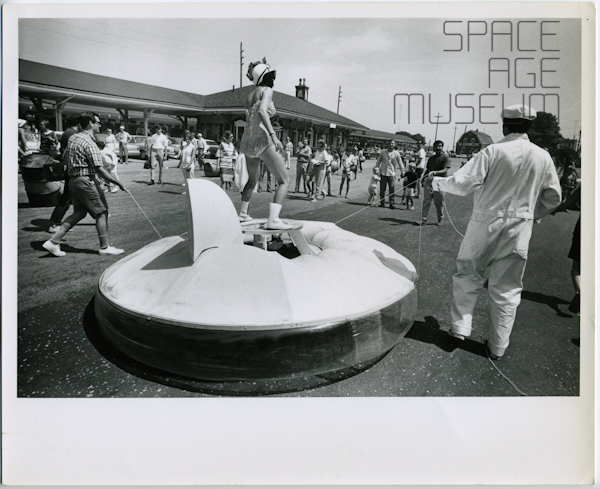 Woman Balances on Flying Saucer Hovercraft (circa 1970)