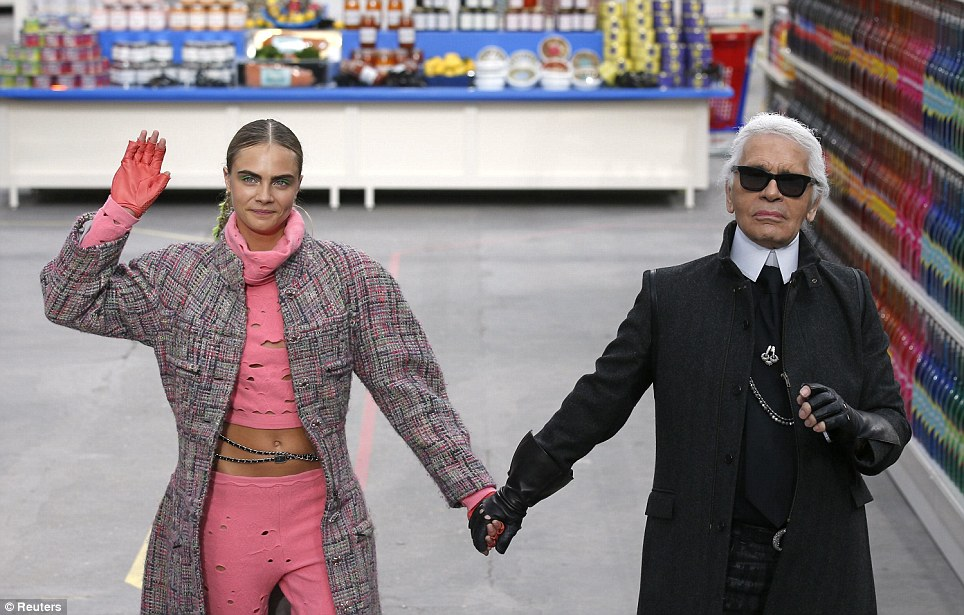 Cara Delevingne and Karl Lagerfeld at Chanel AW14 supermarket-themed show.