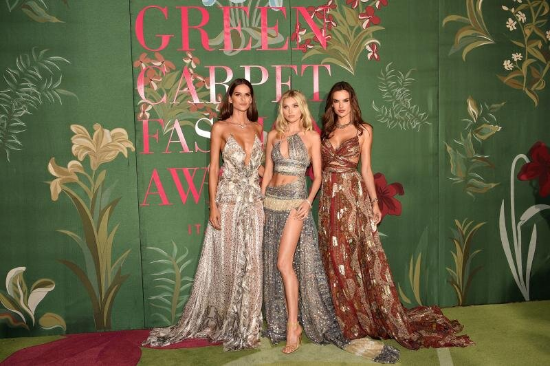 Alessandra Ambrosio, Elsa Hosk, and Izabel Goulart wear Etro for the Green Carpet Challenge. The gowns are made of printed silk chiffon from the Etro archives and finished with repurposed components from pre-existing samples. (Photo: eco-age.com)