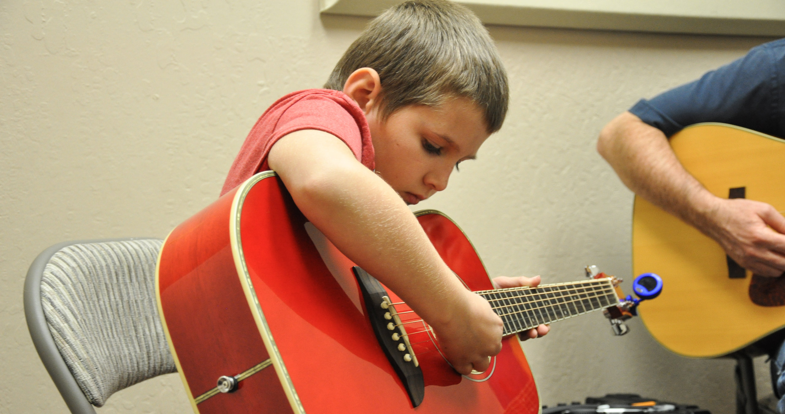 Samy with guitar.jpg