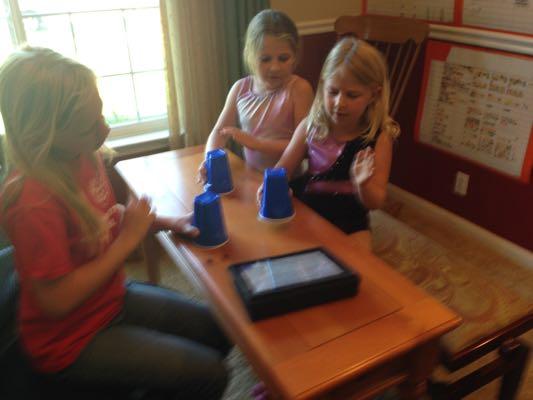Playing rhythm cup games