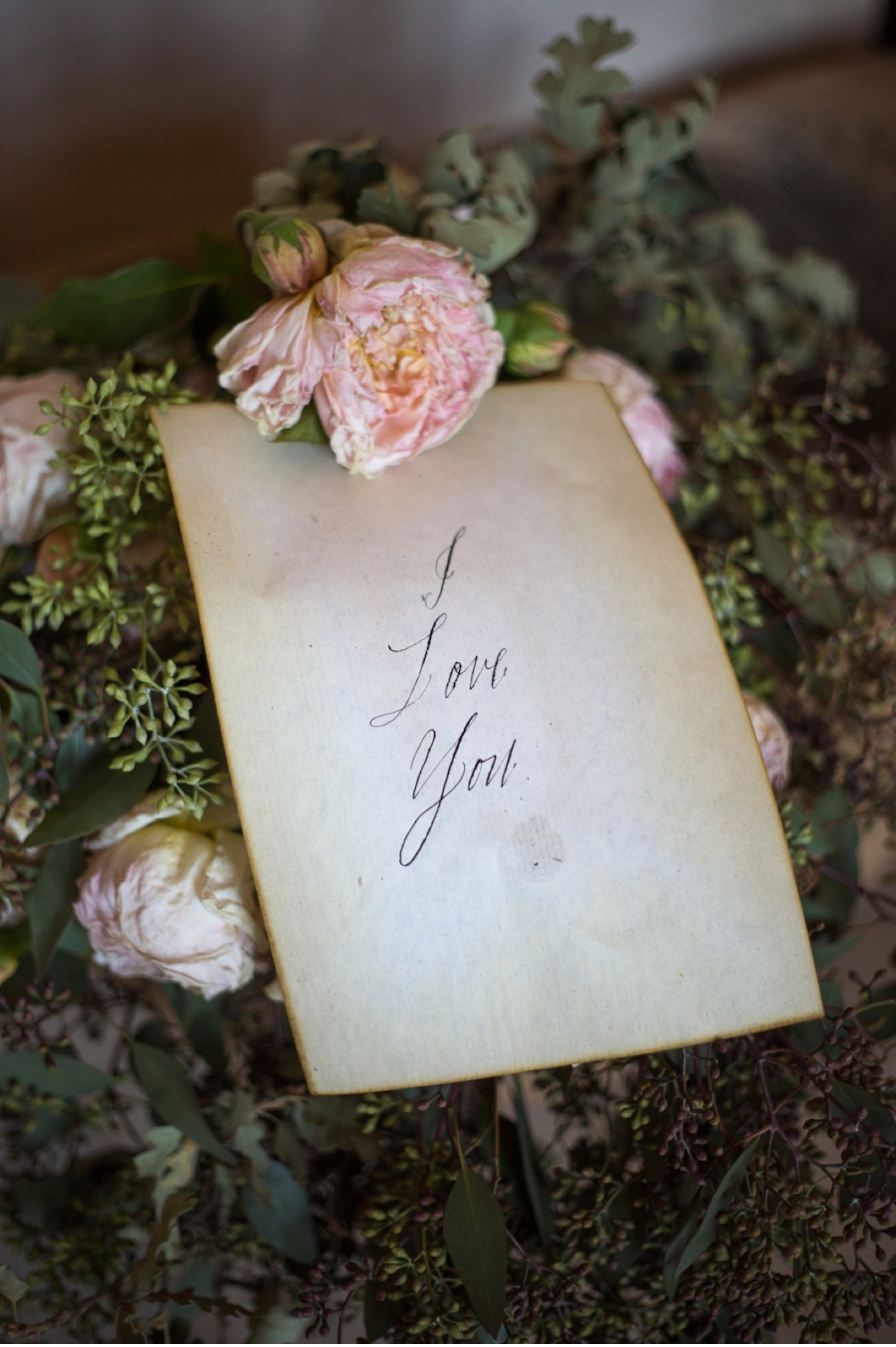 19. Three simple words on parchment style paper say it all.From Elizabeth Messina's  A Lovely Workshop  with calligraphy by  Maybelle Imasa-Stukuls  and photography by  Maru Photography  .
