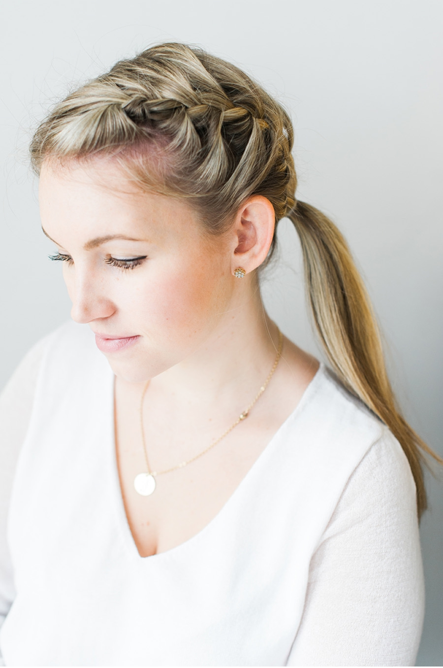  STEP 3 Pull all of your hair, including thebraid, into a side pony tail. Tie off with a clear elastic and remove the elastic on thebraid.