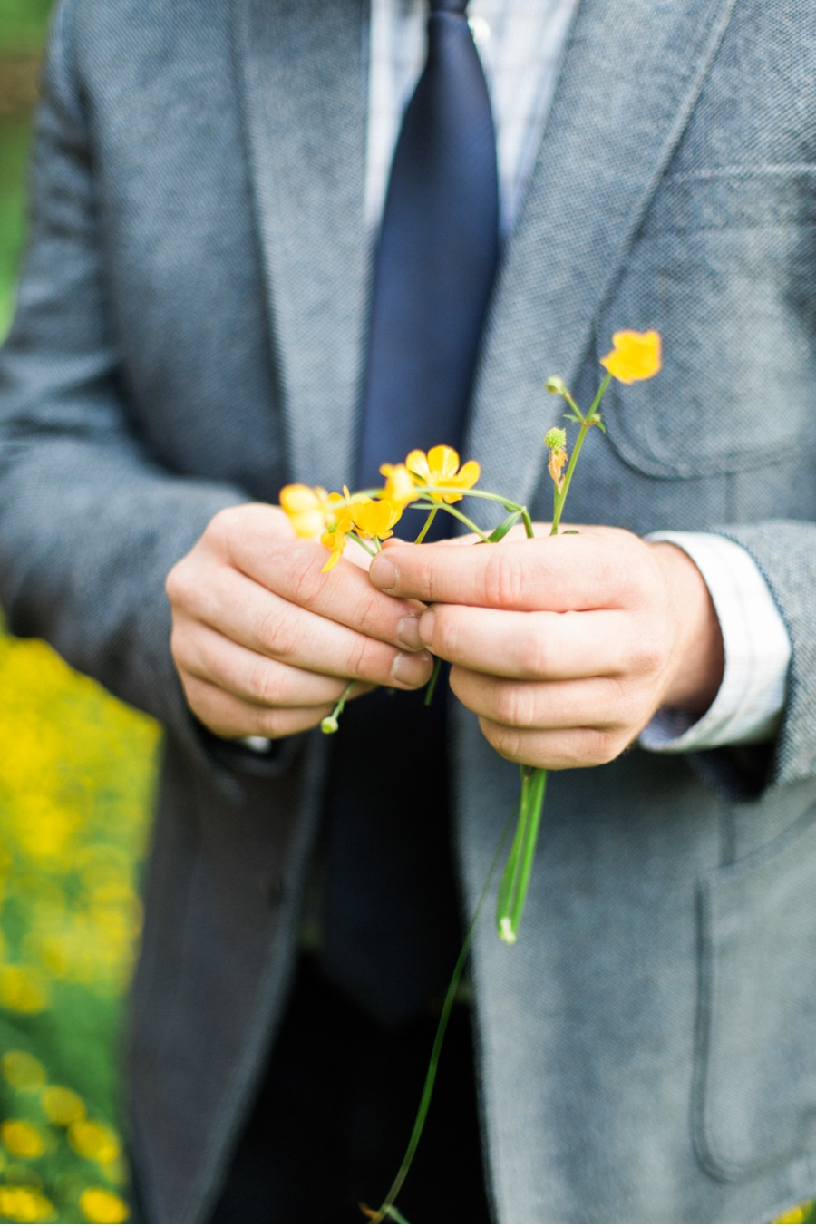 Groom-with-yellow-wildflowers