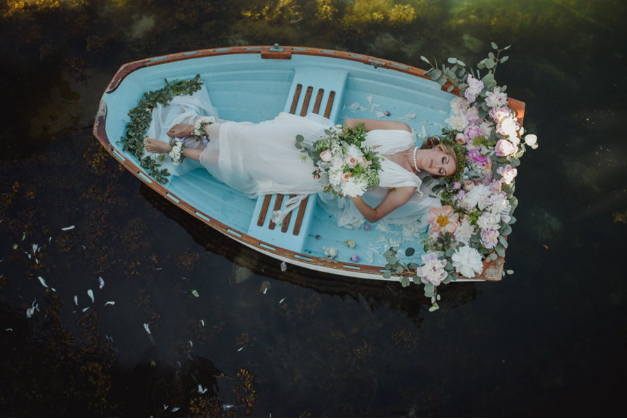 Bride-in-floral-decorated-boat